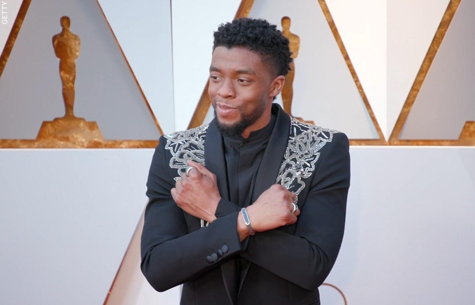 Chadwick Boseman poses at an award ceremony.